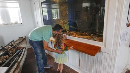 Nick Costanzo of Naples, Fla., shows his daughter