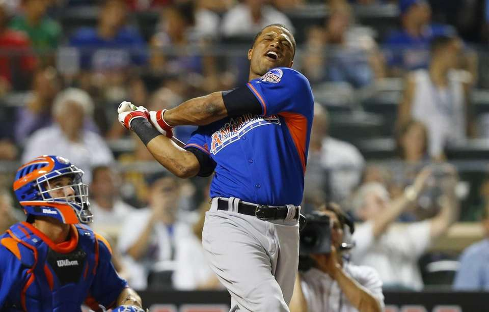 Robinson Cano reacts after missing a home run