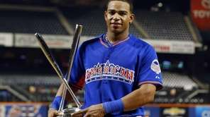 Yoenis Cespedes celebrates his Home Run Derby win