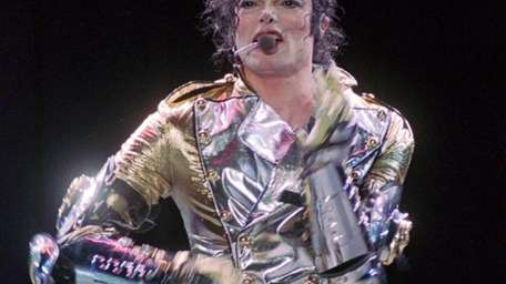 Michael Jackson belts out a song during the