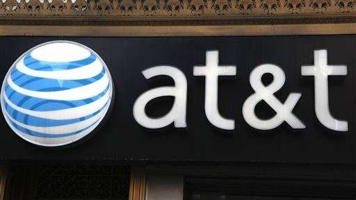 An AT&T sign is seen at a store