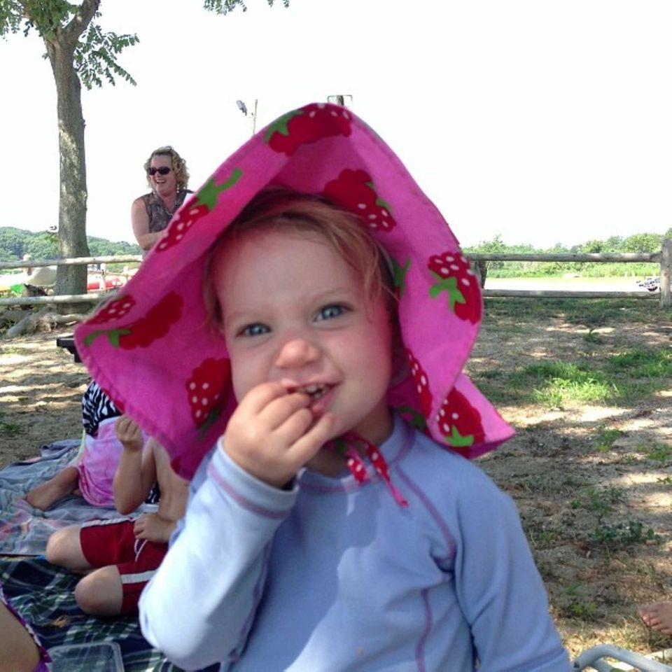 Lena McAree, 18 months, of Bayville, enjoys Storytime