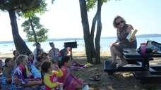 Librarian Jill Abbatangelo reads stories to kids gathered