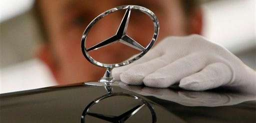 A worker fixes the Mercedes logo on Feb.