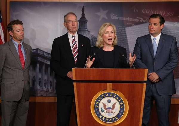 Sen. Kirsten Gillibrand (D-NY) speaks while flanked by