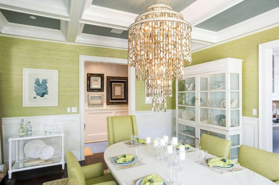 A formal dining room designed by Skye Kirby