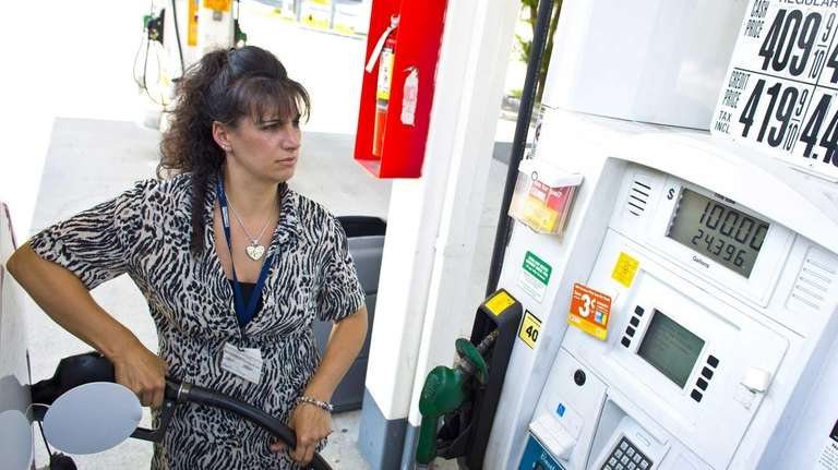 Christine Curry, of Commack, fills her gas tank