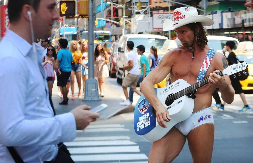 The 'Naked Cowboy' performs in the midday heat