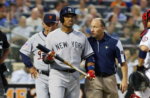 Robinson Cano of the American League is tended
