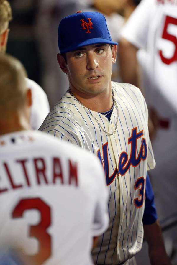Matt Harvey is congratulated in the dugout after
