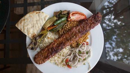 Adana kebab, a long, hand-minced meat kebab, is