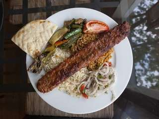 Adana kebab, a long, hand-minced meat kebab, is