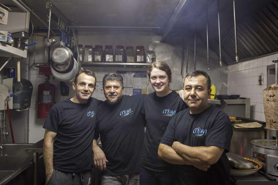 Owner Tuncay Kola, left, with his kitchen staff