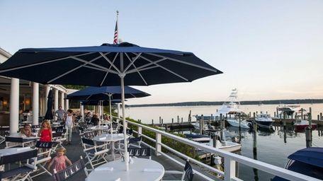 East Hampton Point's deck overlooks Three Mile Harbor.