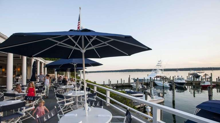 East Hampton Point's deck overlooks Three Mile Harbor.