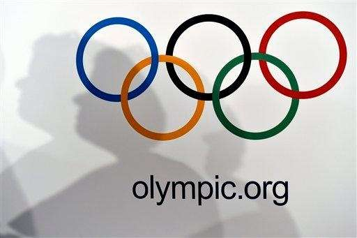 The Olympic rings are seen against a white