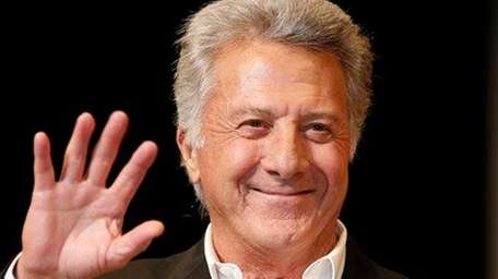 Dustin Hoffman waves to fans in Tokyo during