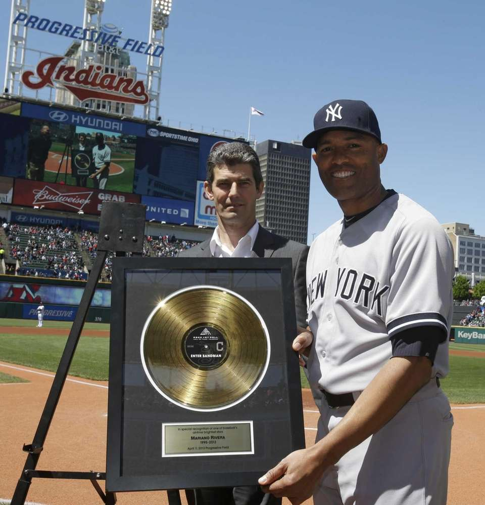 CLEVELAND INDIANS Rivera holds up a gold record