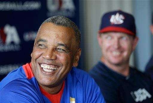 Cuba manager Victor Mesa looks on during a