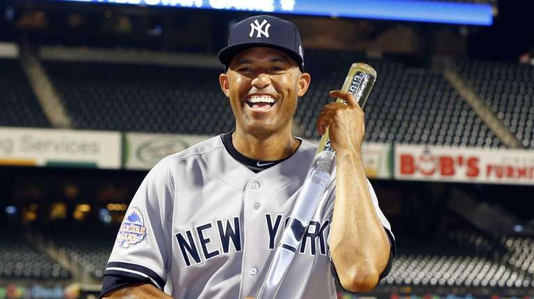 Mariano Rivera poses with the MVP trophy after