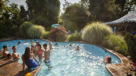 Kids and teens cool off in the backyard