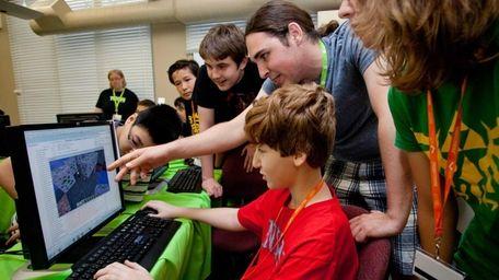 At the keyboard, Jack Dauber, 13, of Oceanside