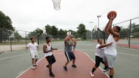 A group of men shoot hoops at Kennedy