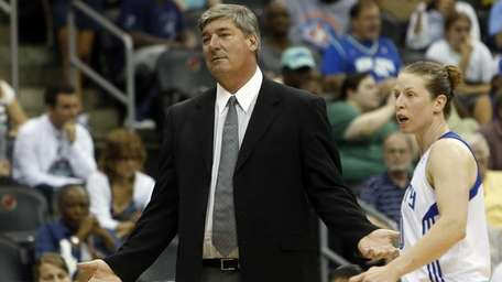 Liberty head coach Bill Laimbeer is joined by