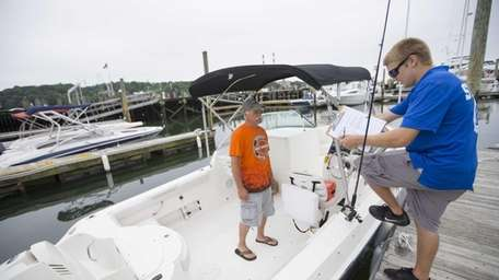 Scott McMaster from Holbrook, boards a Striper for