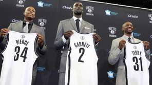 Paul Pierce, Kevin Garnett and Jason Terry hold