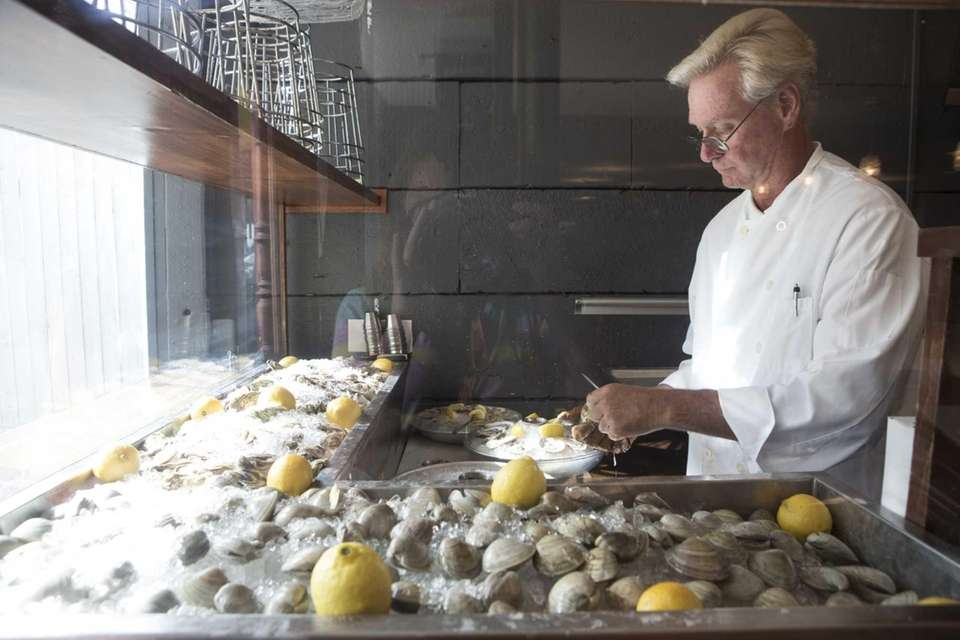 Bruce Hopke shucks clams at Main in Greenport.