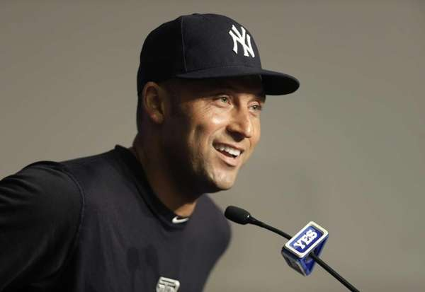Derek Jeter smiles while taking questions from reporters