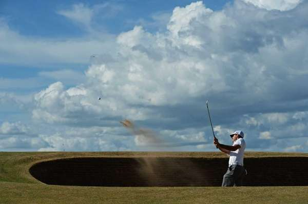 Charl Schwartzel of South Africa hits a shot