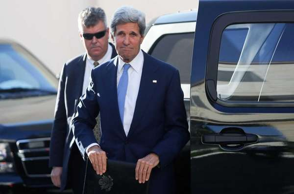 Secretary of State John Kerry waves as he