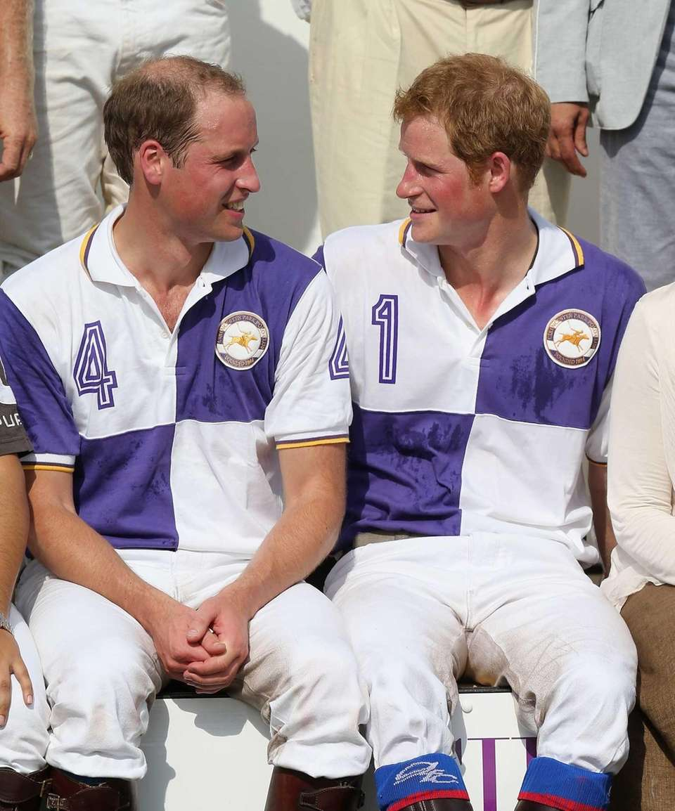 Britain's Prince William and Prince Harry after the