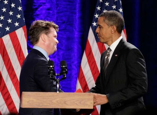 President Barack Obama is greeted by Matthew Barzun,