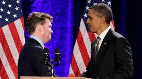 President Barack Obama is greeted by Matthew Barzun,