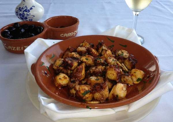 Braised octopus with olive oil, garlic and paprika
