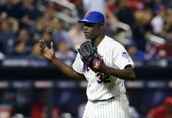 LaTroy Hawkins of the Mets reacts after getting
