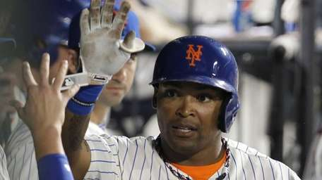 Marlon Byrd of the Mets celebrates in the