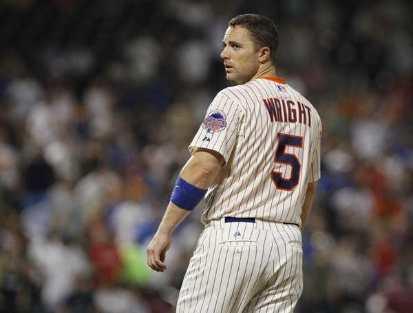 David Wright of the Mets reacts after goriunding