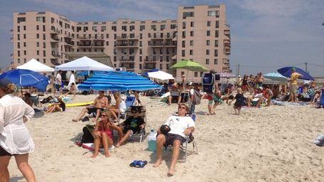 Beachgoers soak up some sun in Long Beach.