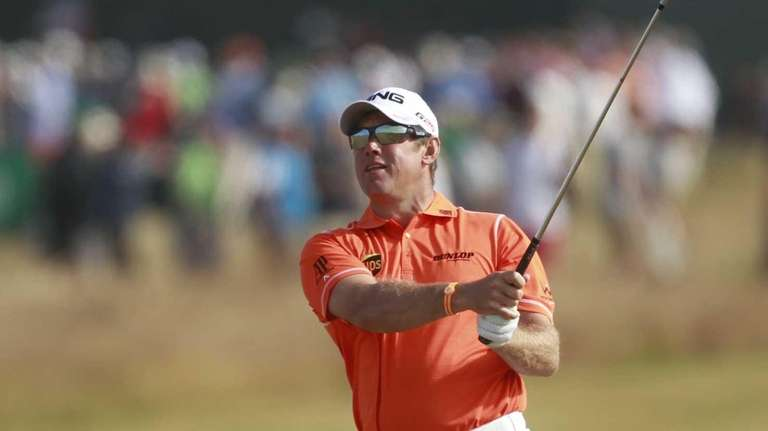 Lee Westwood of England plays a shot on