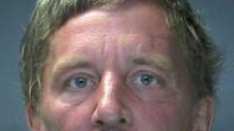 Glen Gregor, of Patchogue, is arrested after police