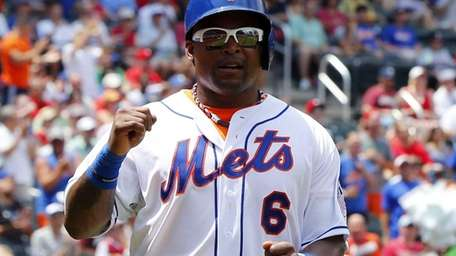 Marlon Byrd celebrates his first-inning run against the