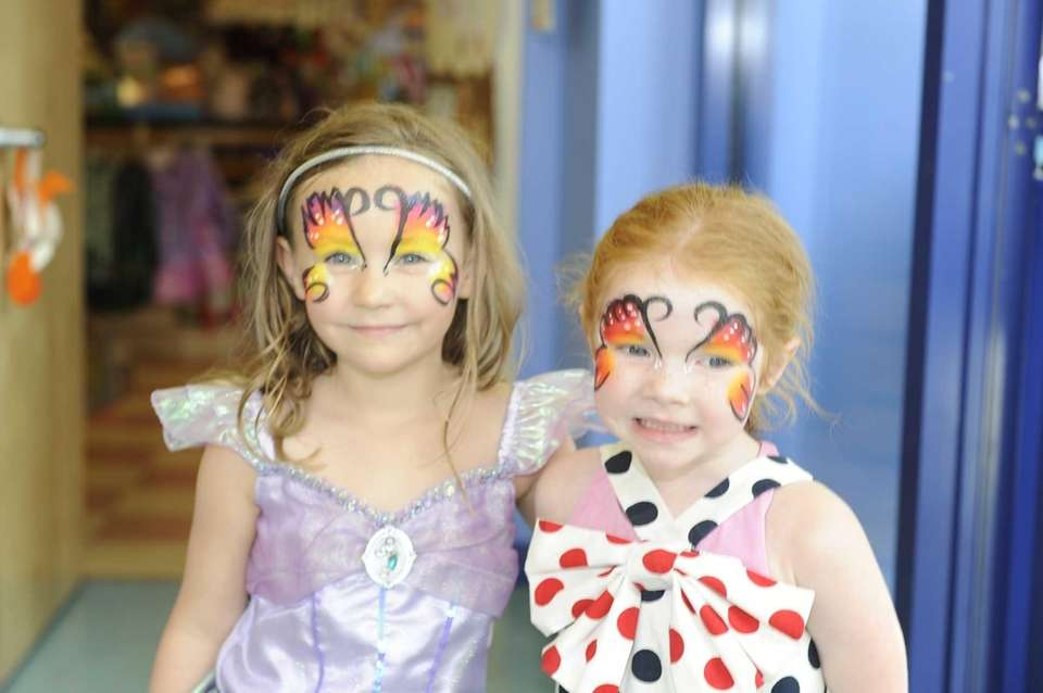 Charllette Guffey and Elaney Foster, both 4, spend