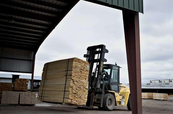A stack of bass wood lumber is moved