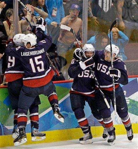 USA players celebrate after a goal by Zach