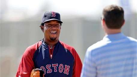 Former Boston Red Sox pitcher Pedro Martinez, left,
