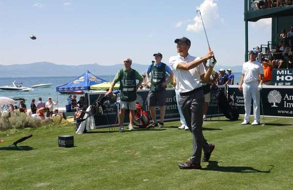 Golden State Warriors' Stephen Curry watches a tee